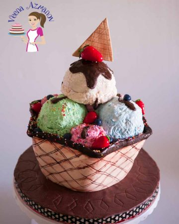A cake decorated like a big cone of ice cream.