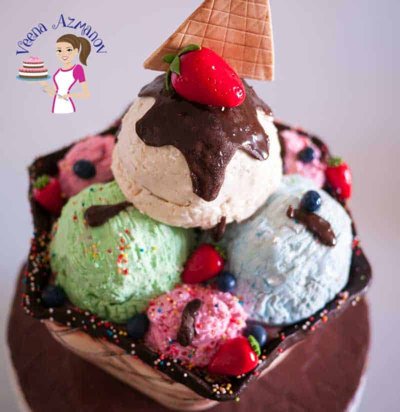A cake decorated like a big ice cream sundae.
