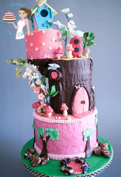 A cake decorated to look like an enchanted forest birdhouse.
