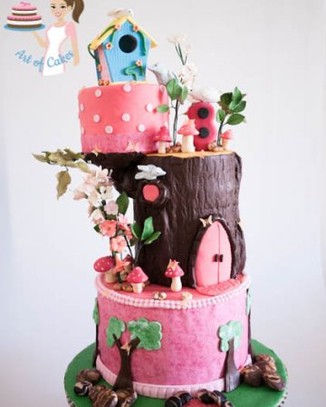 A cake made to look like an enchanted forest birdhouse.