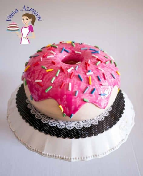 A Doughnut Cake Tutorial. A video tutorial showing how to make a donut cake with fondant covered cake, fondant sprinkles and more.