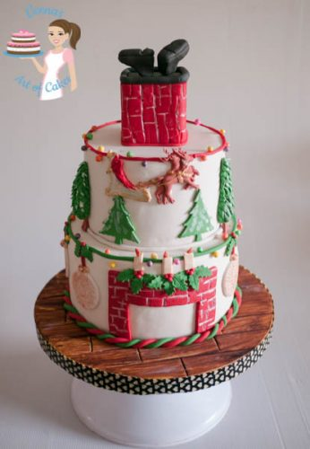 Christmas greetings veena 39 s art of cakes Santa stuck in chimney cake