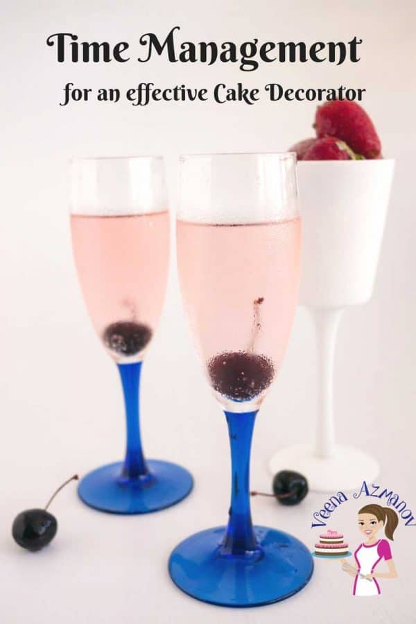 Two wine glasses filled with pink champagne.
