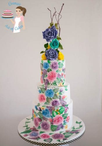 A hand painted roses wedding cake.