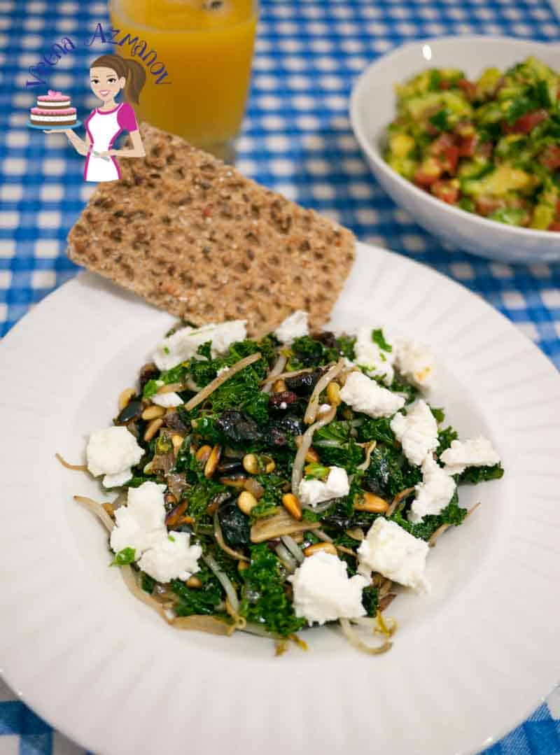 Simply healthy Kale with Pine nuts, Cranberries and Feta Cheese is delicious and yet healthy recipe that is perfect for brunch lunch or a week night dinner. You can serve it as a side dish or make it a light and healthy meal on it's own.