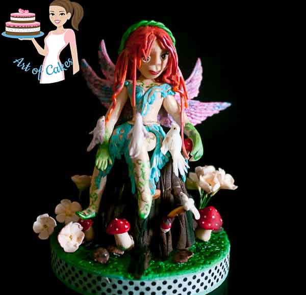 A cake decorated to look like a woodland fairy.