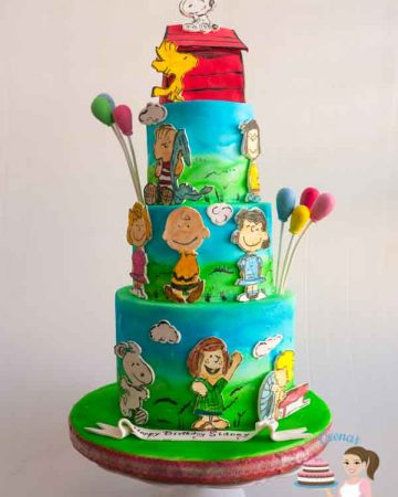 A cake decorated with the Peanuts comic theme.