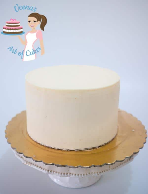 A buttercream cake with sharp edges.