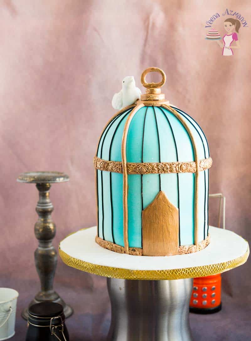 A cake decorated to look like a vintage bird cage.