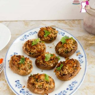 A platter of Mushroom Appetizers with stuffing made from bread crumbs.