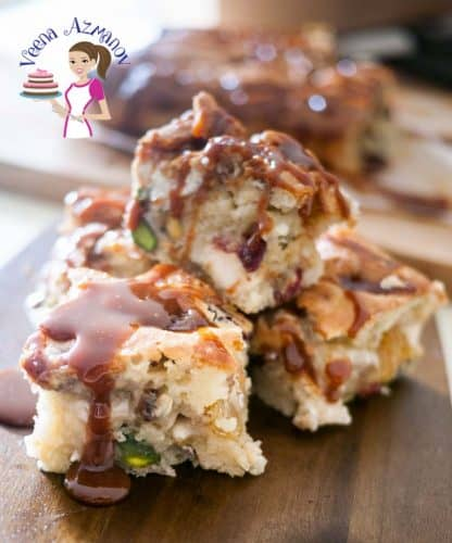 These Caramel Squares with Fruit Nuts and Halva recipe are a perfect tea time cake that absolutely melts in your mouth. The delicious fruit nuts is enhanced with th the sweetness of the halva. The caramel topping just takes it to a whole new experience. I'm very sure you will be adding this to you party favorites.
