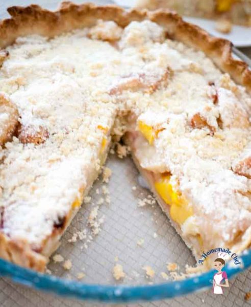 Peach Tart with curmble topping is an absolutely delicious recipe with a few extra steps but well worth the extra effort. The soft peach filling almost melts in the mouth while the crumble stays nice and crispy by food blog A Homemade Chef