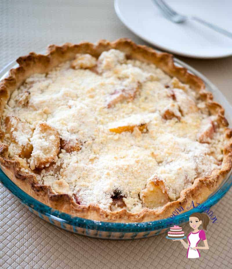 Peach Tart with crumble topping is a perfect summer dessert when peaches are in season. The soft peach filling almost melts in the mouth while the crumble gives a nice buttery crisp crunch.