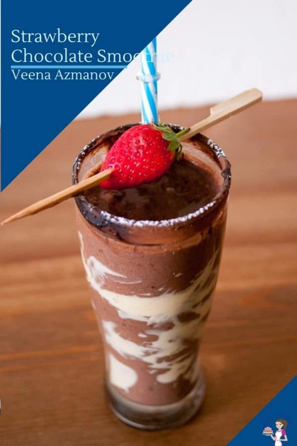 A smoothie garnished with strawberry and cocoa