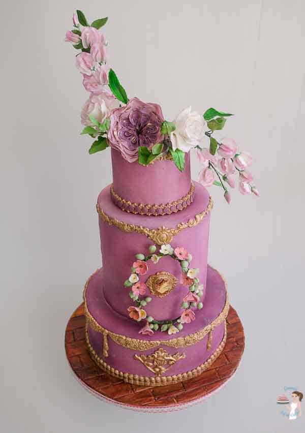 A top view of a 3-tier Cake for the Queen with sugar flowers.