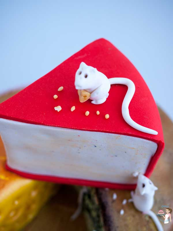 A Fondant Cheese and Mice Cake is a fun novelty cake perfect for any age or gender. This step by step tutorial makes it look so easy you will be surprised.