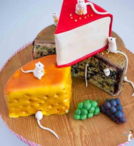 Artistic Cheese Cakes is a fun novelty cake to make and perfect for any age or gender. This step by step tutorial makes it look so easy by Veena Azmanov of Veenas Art of Cakes