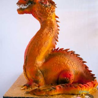 Dragon Cake - A gravity defying cake , made with fondant, modeling chocolate and airbrushed by Veenas Art of Cakes
