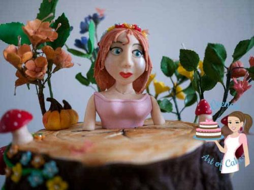 A cake decorated to look like an enchanted forest princess.