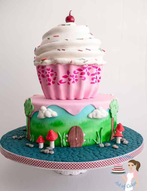 A decorated giant cupcake cake