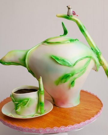 a teapot cake on a cake board