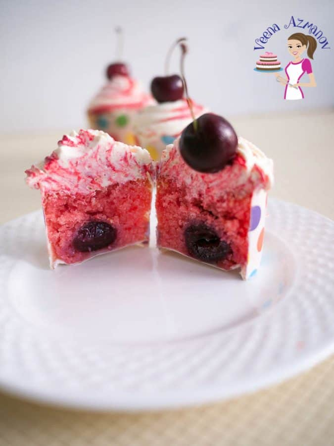 Cherry cupcake cut in half.