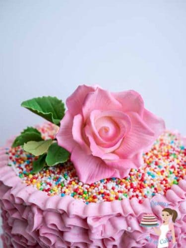 Pink Buttercream Ruffles Cake. The ruffles are made with Swiss meringue buttercream. You can find the recipe for SMBC as well as how to pipe the ruffles on this post by Veenas Art of Cakes
