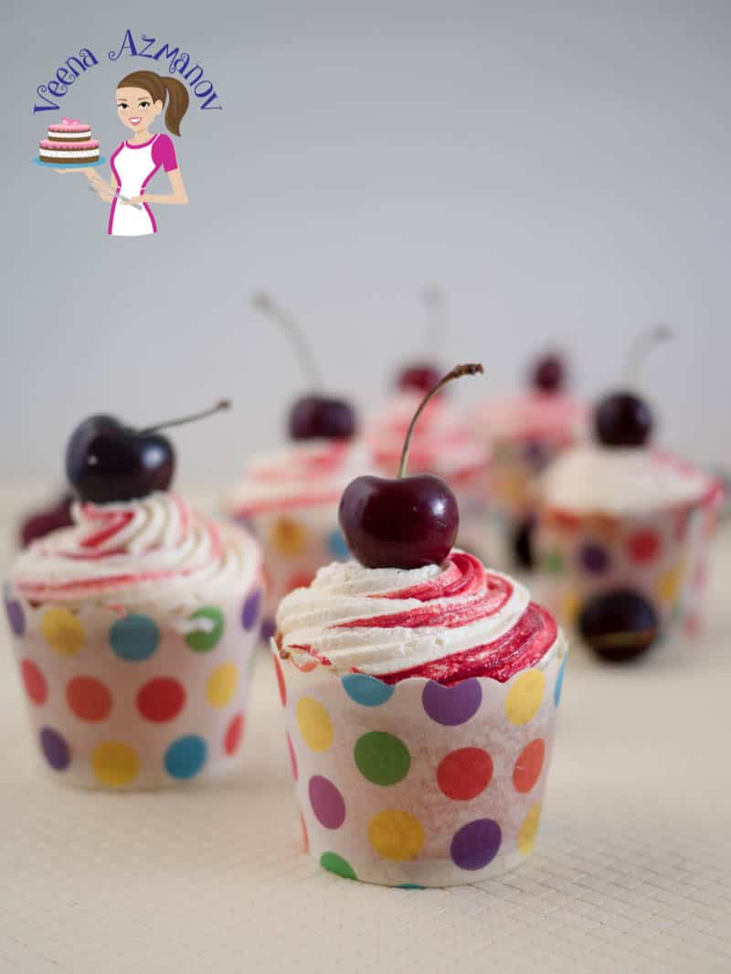 These Pink Cherry Cupcakes are so simple to make with a cherry flavor batter, a quick cherry filling, topped with my light whipped cream buttercream and adorned with a cheery on top