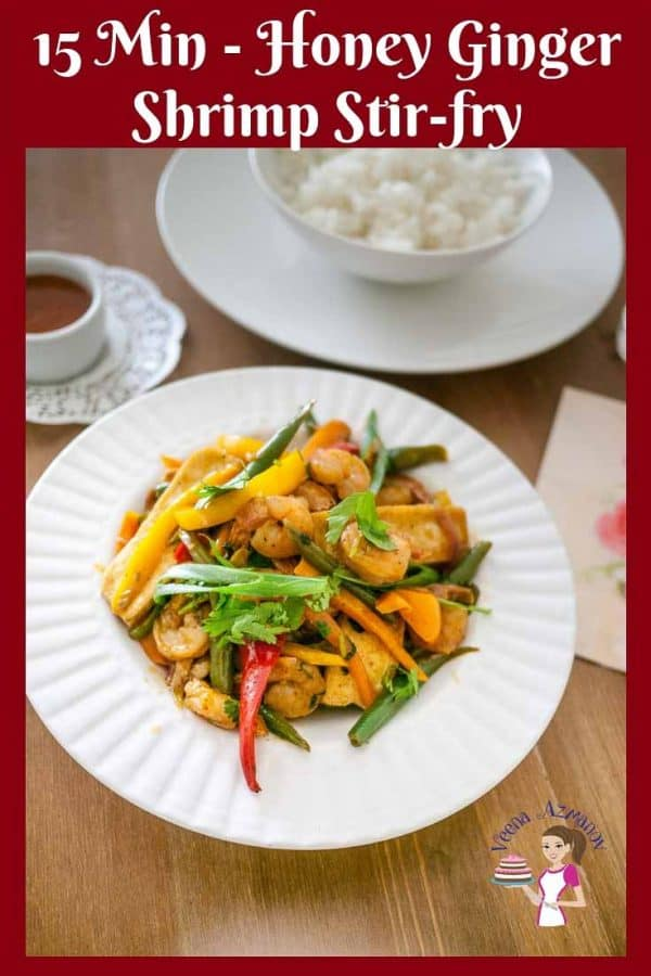A quick 15 minutes honey ginger shrimp stir-fry with vegetables served with steamed rice.
