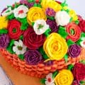 A cake decorated to look like a basket of flowers.