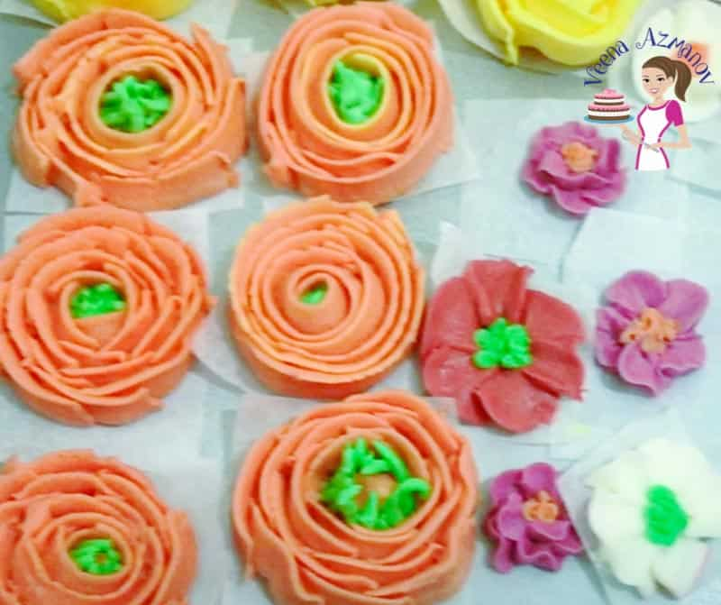 Buttercream Icing flowers ready to be frozen on a tray.