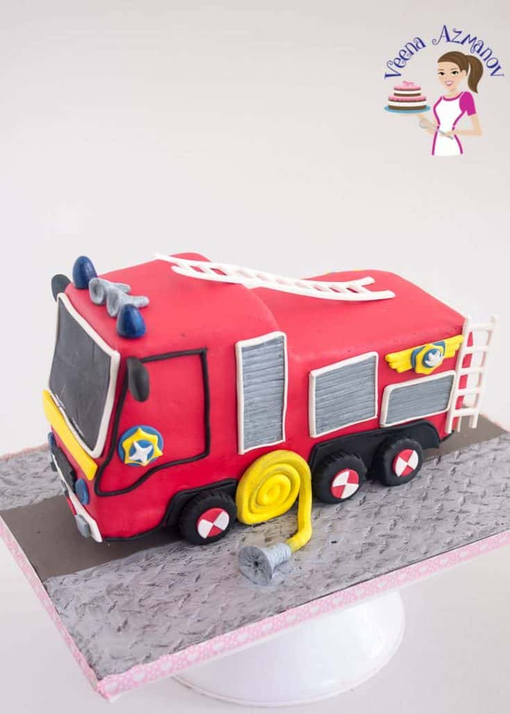Make a Fire Truck Cake for you kids next birthday celebration with this step by step progress pictures and video tutorial #firetruck #cake #novelty #tutorial #easy