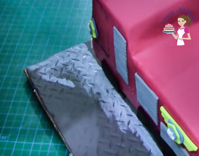 Progress photos of making a fire truck cake.