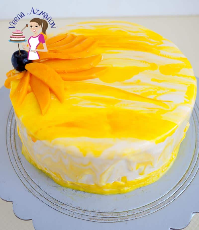 Images showing the side view of the mango mousse with jello insert for the Vegetarian Mirror glaze aka shiny cakes made without gelatin using agar agar.