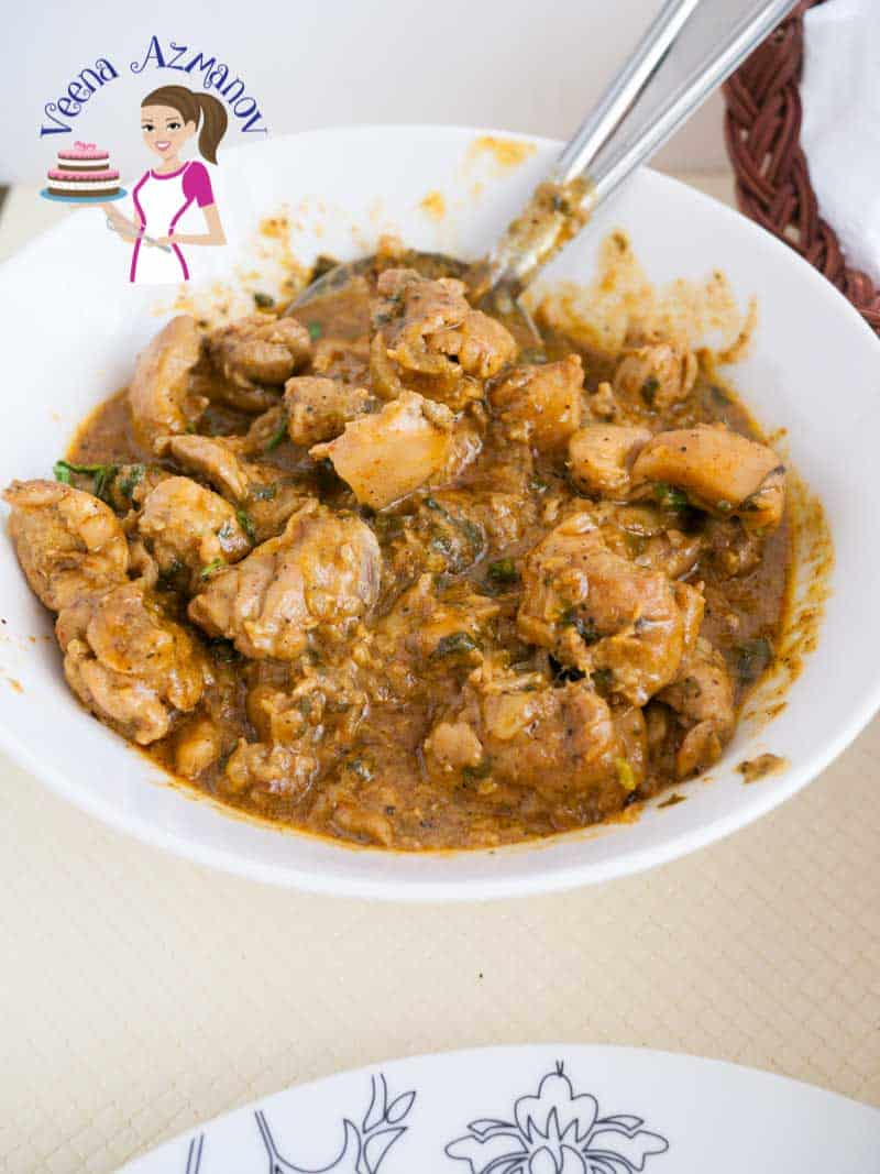 A bowl of easy chicken curry with few ingredients showcasing the chicken pieces in a while bowl.