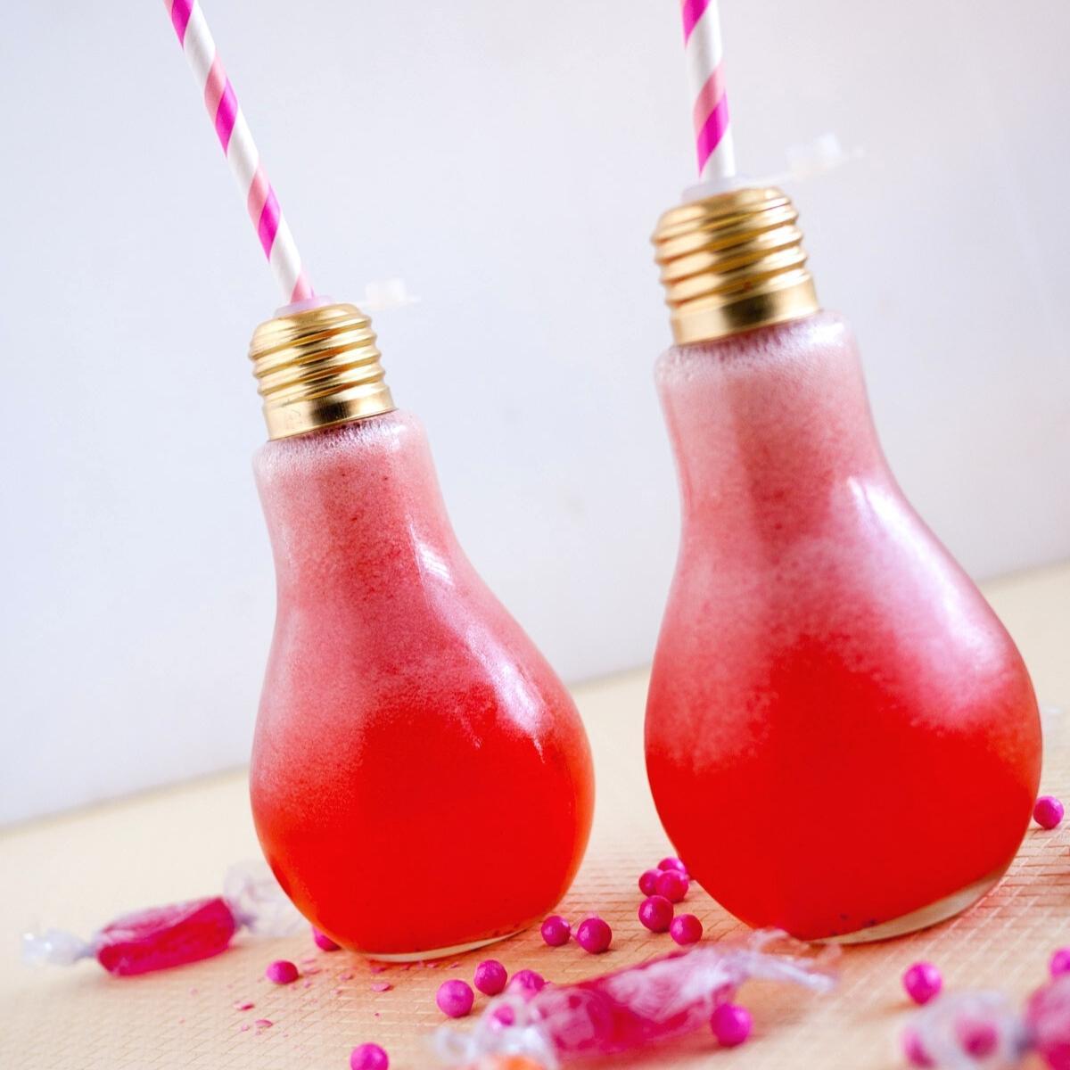 two light bulb shaped glasses with lemonade