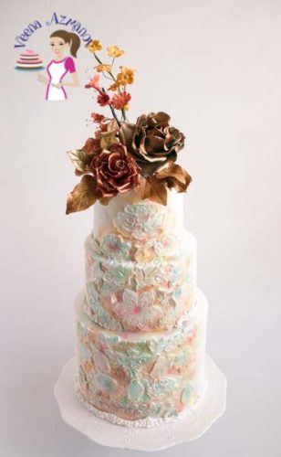 Vintage mixed media white wedding cake was made for a crafty bride that loves to create greeting cards and other mixed media stuff using flowers, sprays etc. Here's a little insight on how I made her cake.