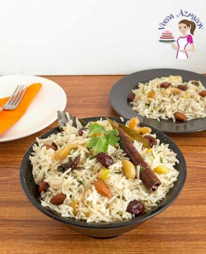 A bowl of rice pilaf with dried fruit.
