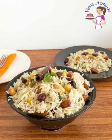 A vegetarian rice made with fruits and nuts served in a black bowl