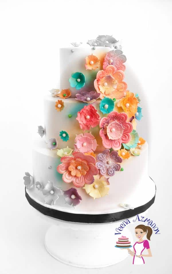 This is my recent creation - Blossoms White Wedding Cake made for a lovely bride that wanted to have a cake full of flowers.