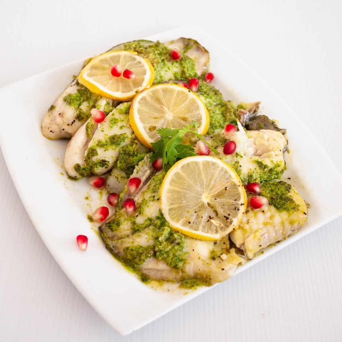 Baked fish fillets on a serving platter.