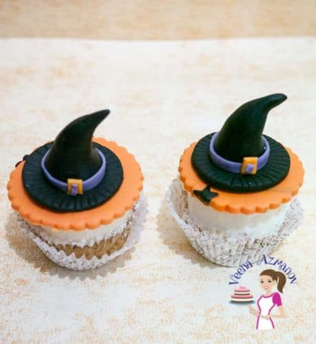 The most common; simple and easy cupcake topper that everyone loves during Halloween is a Witch's Hat Cupcake topper to top your favorite cupcakes.