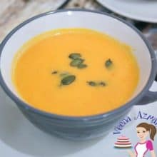 A bowl with soup made with pumpkins.