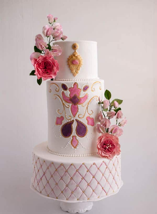 A cake decorated with an embroidery theme.