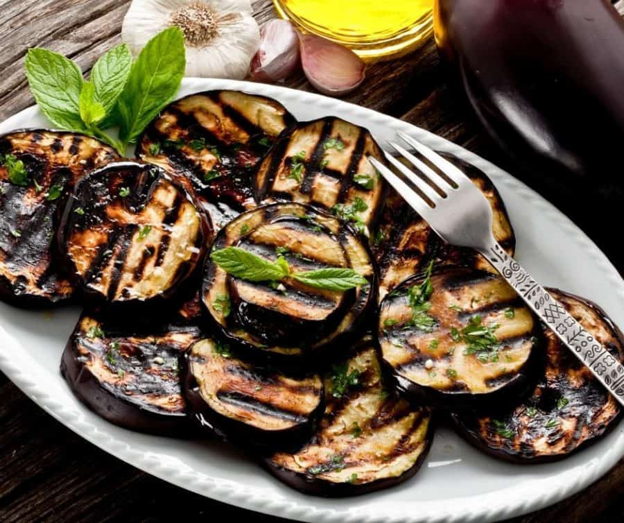 A stack of roasted slices of eggplant on a try.
