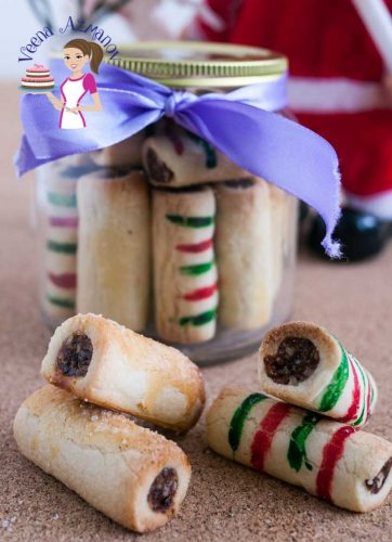 Date Roll Cookies are a Christmas tradition in my family. The sweet and nutty filling wrapped up in butter based cookie dough just melts in the mouth. So delicious you can't stop eating. This cookies uses macadamia but pecans or walnuts make an equally delicious combination with dates.