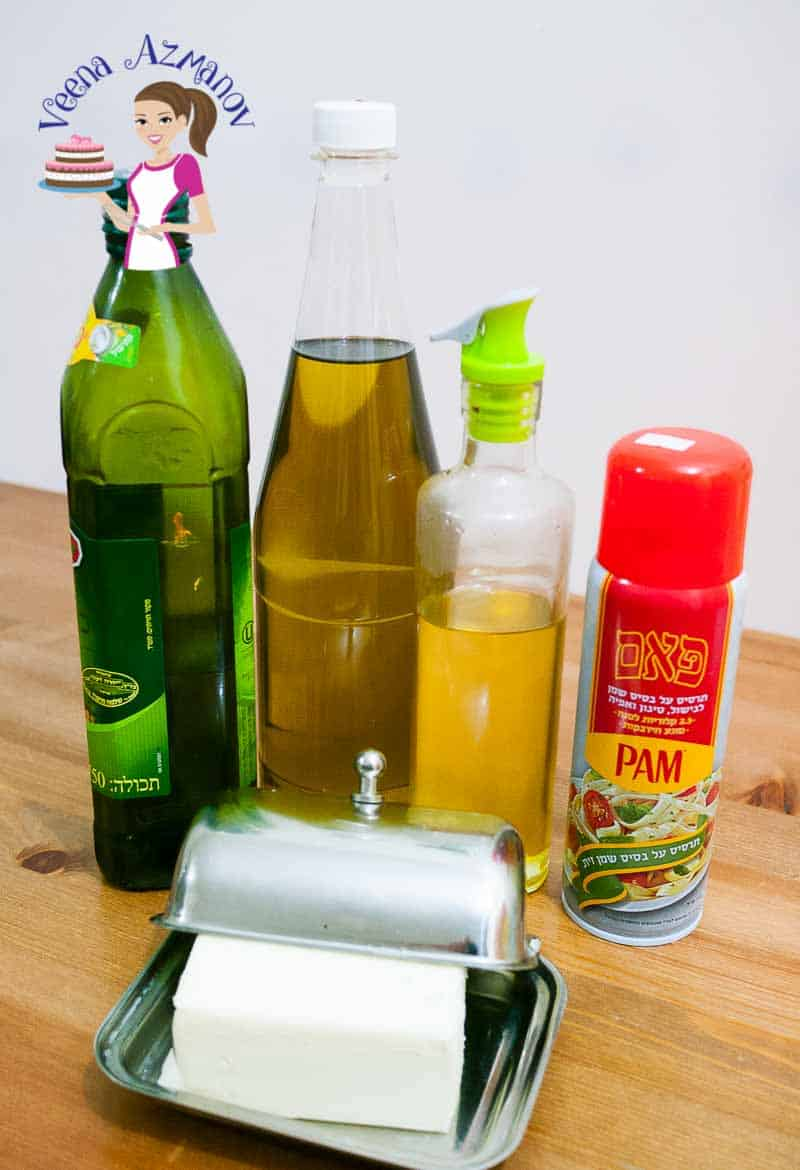 Four bottles of vegetable oils on a table.