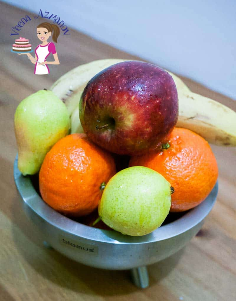 A bowl of fruits on a table.