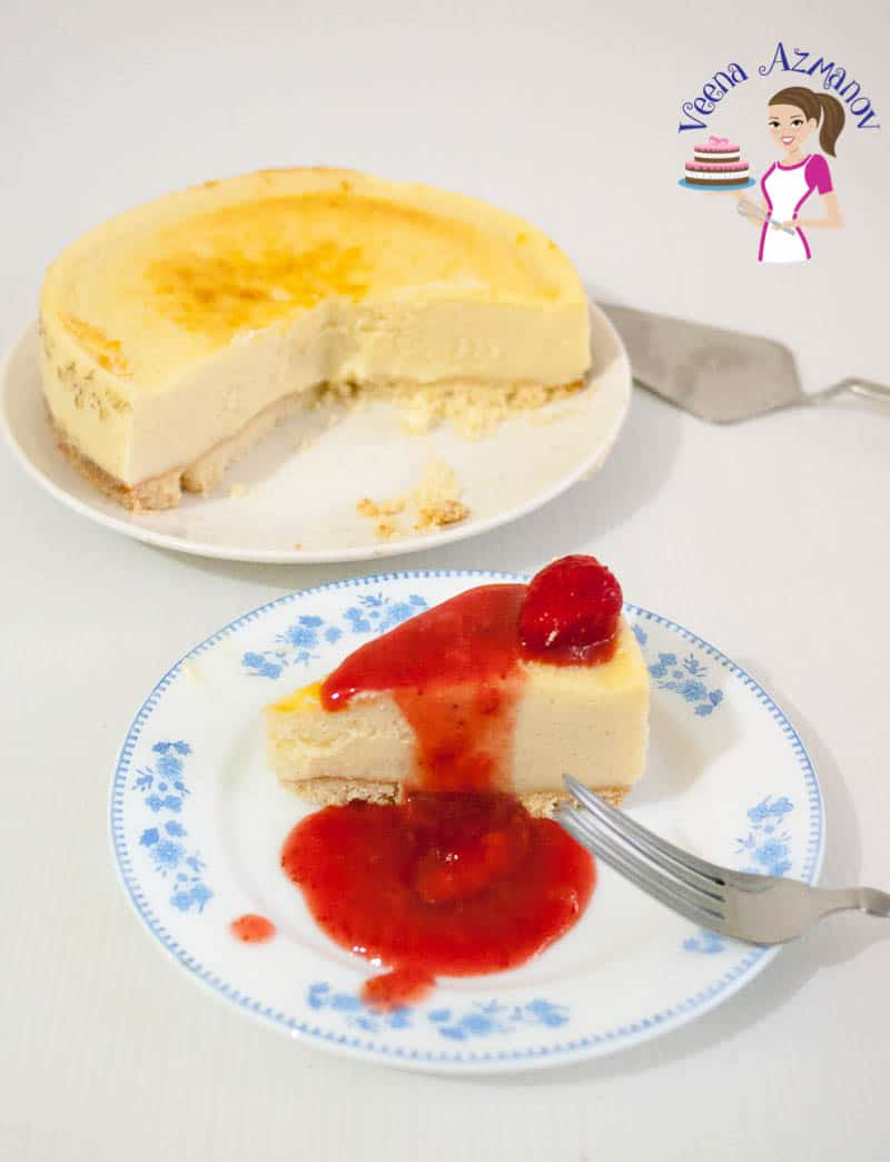 A slice of baked cheesecake with strawberry filling