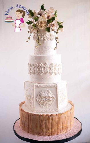 Ending this year sharing with you one final wedding cake. This Cosmos Lace Inspired White Wedding Cake. Inspired by the brides favorite flower the cosmos and wafer paper lace. This white wedding cake with a wood panel on the bottom tier was really fun to create.